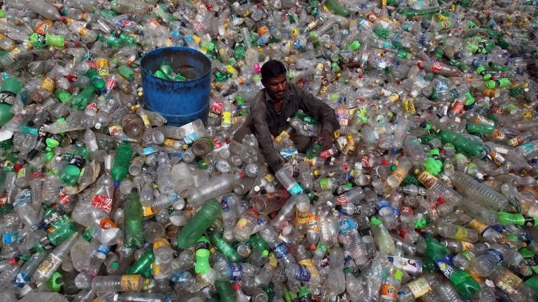 Man surrounded by plastic
