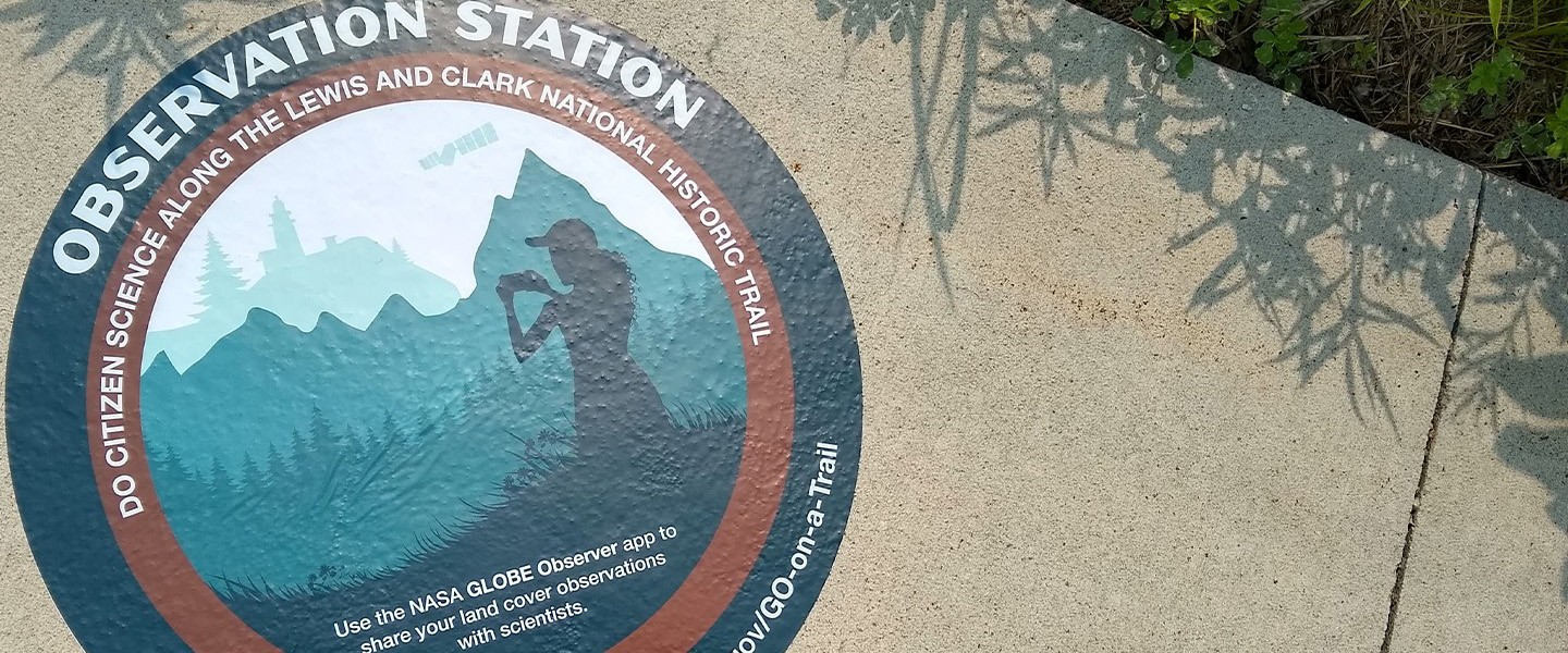 The Go on a Trail logo showing a girl observing the landscape of the mountains.