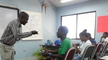 Mr. Olawale Oluwafemi is teaching students in a classroom.