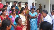 A group of GLOBE Sri Lanka teachers laughing and smiling.