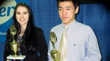 students with trophies