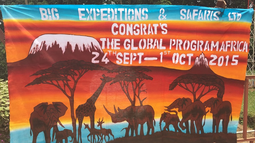 A colorful banner is seen with silhouettes of African animals.