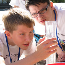 Two students look together at a liquid sample.