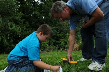 GLOBE Scientist and Partner Dr. Kevin Czajkowski coaches a student on taking surface temperature measurements