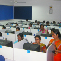 Sri Lanka teachers sitting behind computers learning the biosphere protocol.