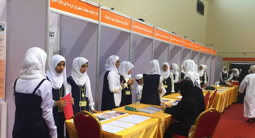 Oman female students getting ready for the GLOBE Environmental Research Fair