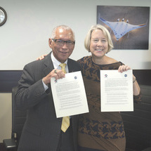 Photo of NASA Administrator Charles Bolden and Peace Corps Director Carrie Hessler-Radelet at signing of the Letter of Intent