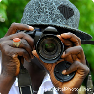 A boy with a camera taking a picture.