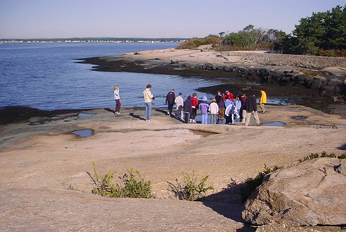 A group of people standing on the Outer Island.