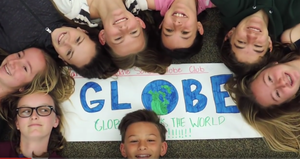 Students laying on the floor for the GLOBE Earth Day video challenge.