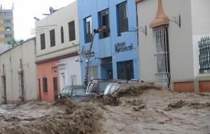 Colorful homes being flooded in Peru.