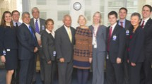 A group photo of NASA and Peace Corps administratives