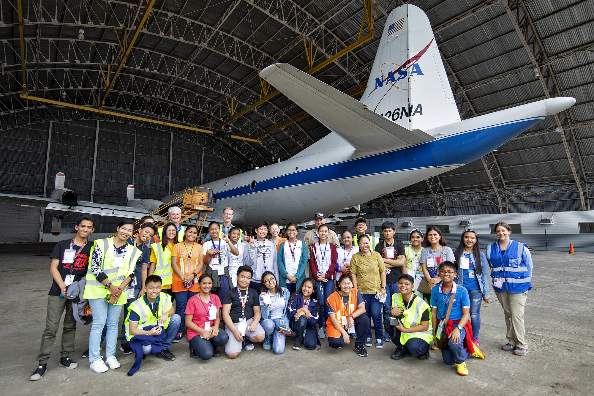 Students and teachers from Batasan Hills National High School and Bagong Silangan High School pose by the NASA P-3 aircraft after their tour of the NASA hangar at Clark International Airport, Philippines, on 14 September 2019.