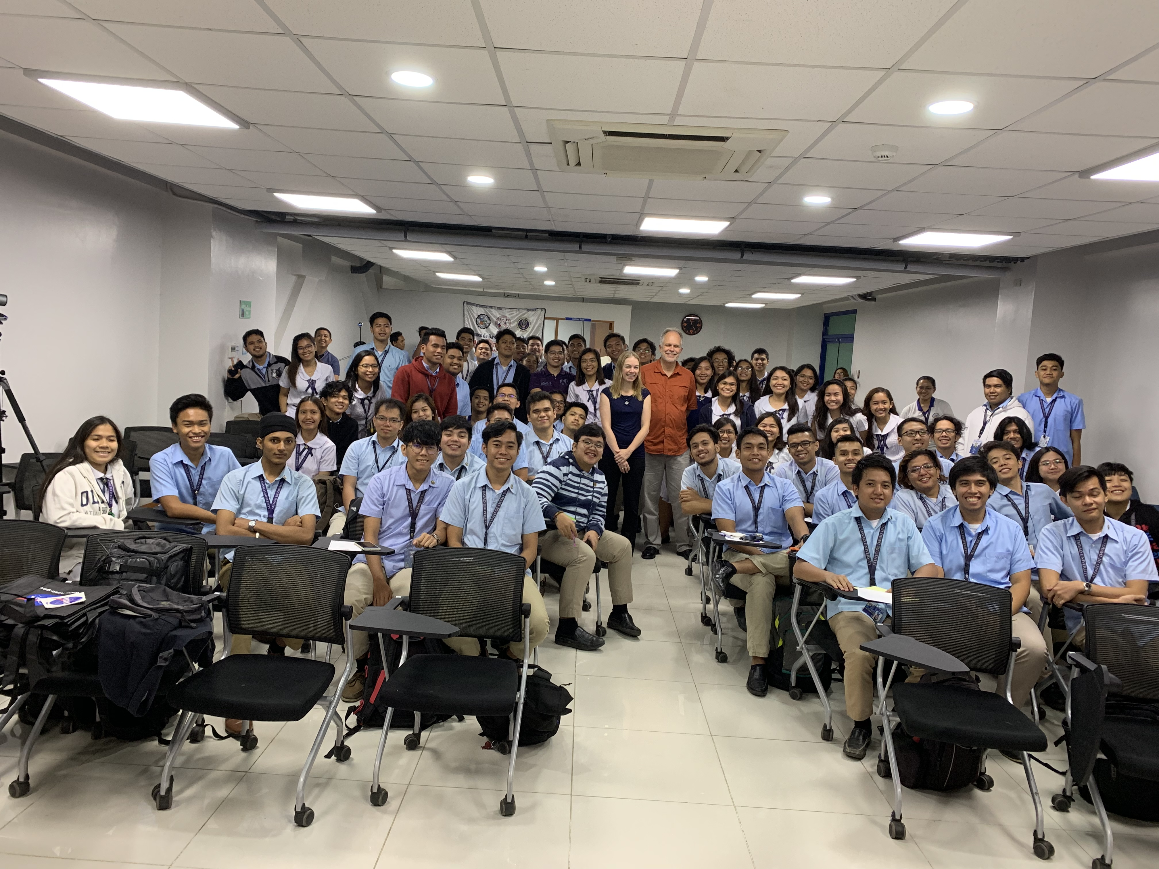 Emily Schaller and Hal Maring pose with 1st and 2nd year university students at Ateneo de Davao University.