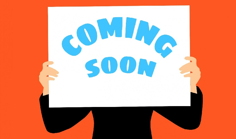 "An illustration of a person holding a ""Coming Soon"" sign."