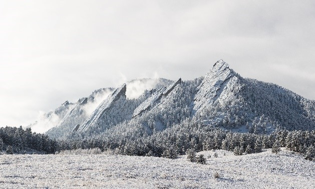 "Photo of the Boulder ""Flatirons"" in the snow"