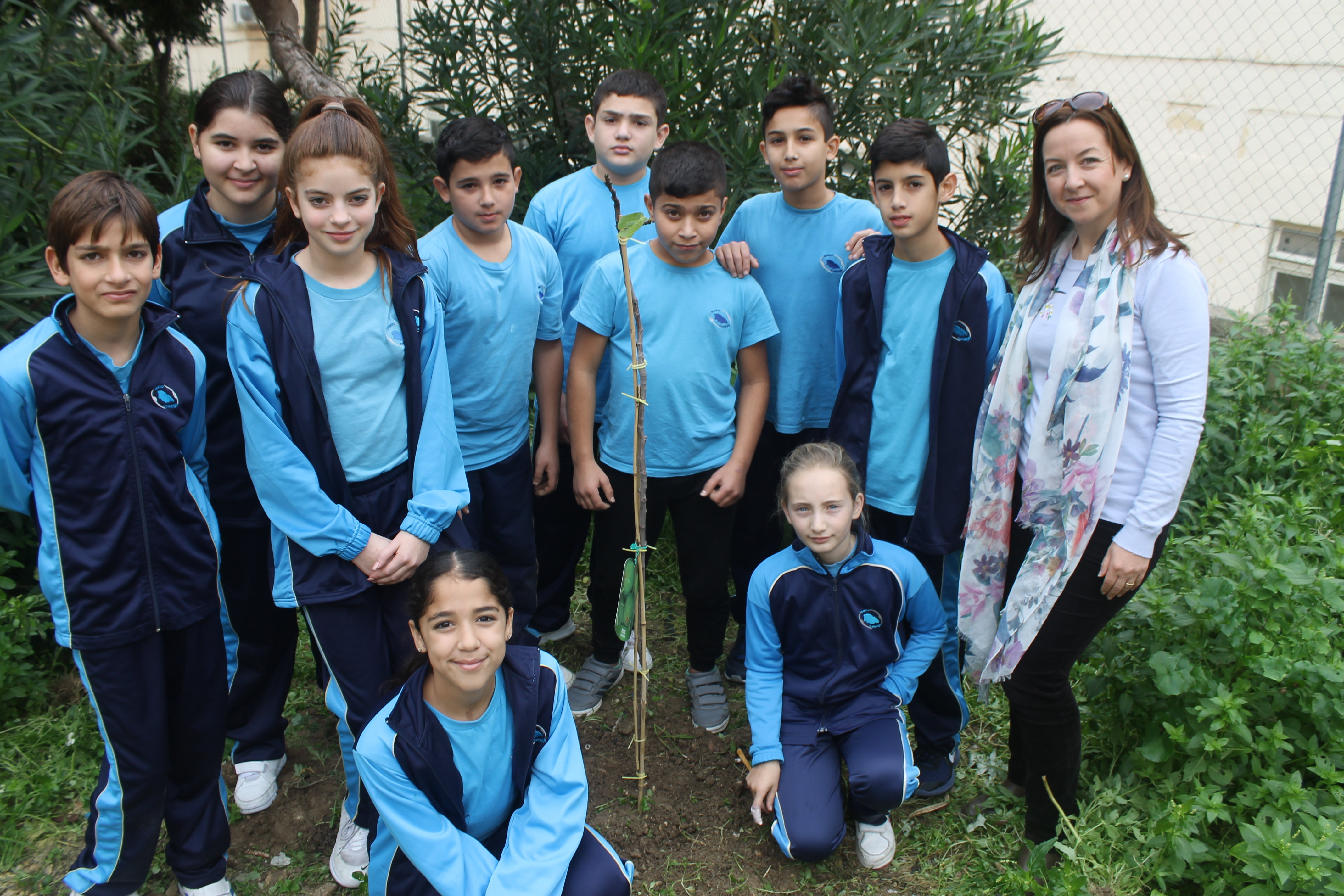 Students from Gozo College Middle School (Victoria, Gozo, Malta), together with their teacher, Ms. Ramona Mercieca, with the newly planted Fig Tree in the school garden.