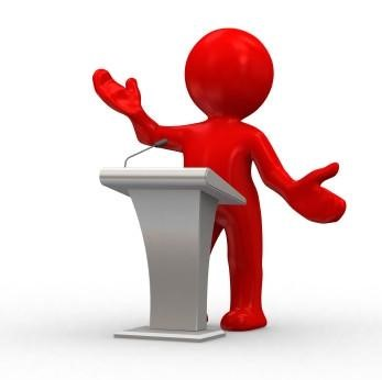 Graphic of a person up at a podium, giving a presentation.