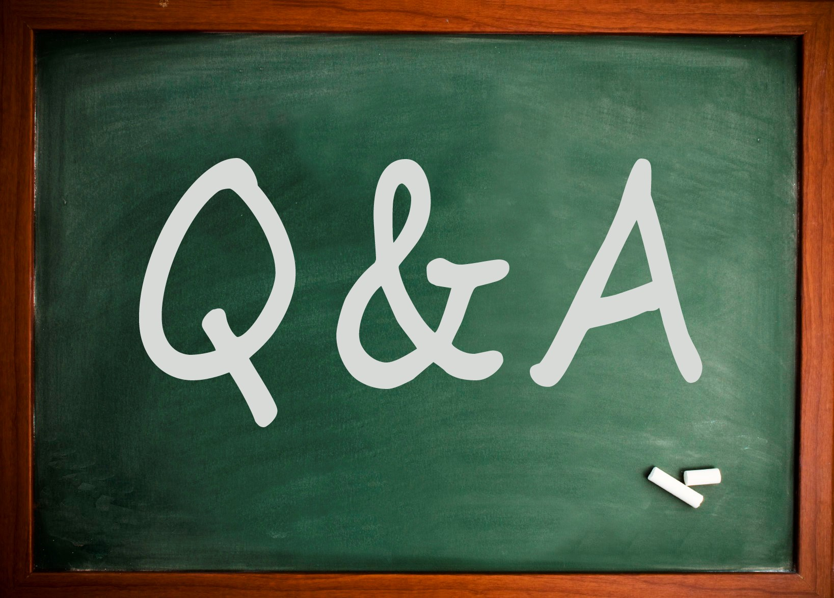 "Photo of a chalkboard with ""Q&A"" written on it."