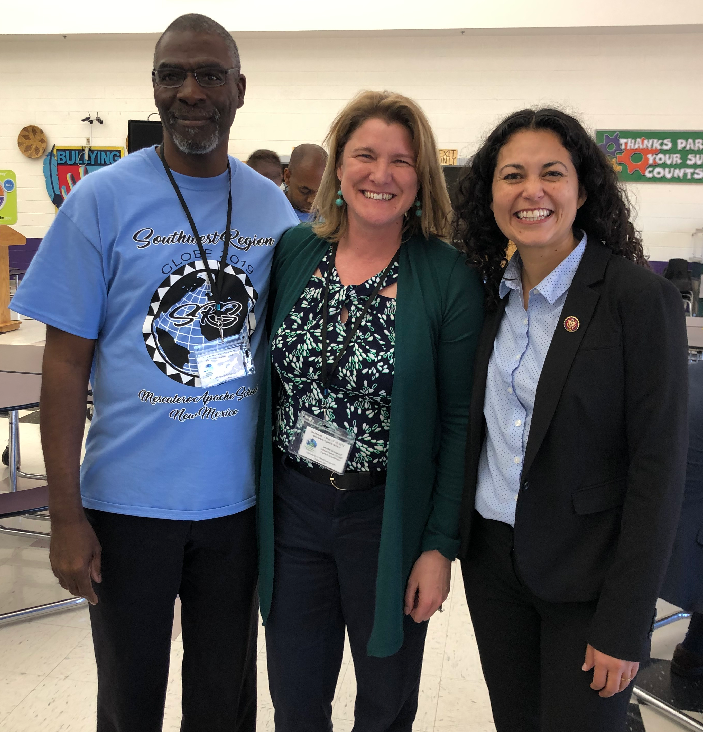 Nate Raynor, teacher and organizer, jennifer Bourgeault, US GLOBE Country Coordinator and Congresswoman Xochiti Torres-Small, smiling.