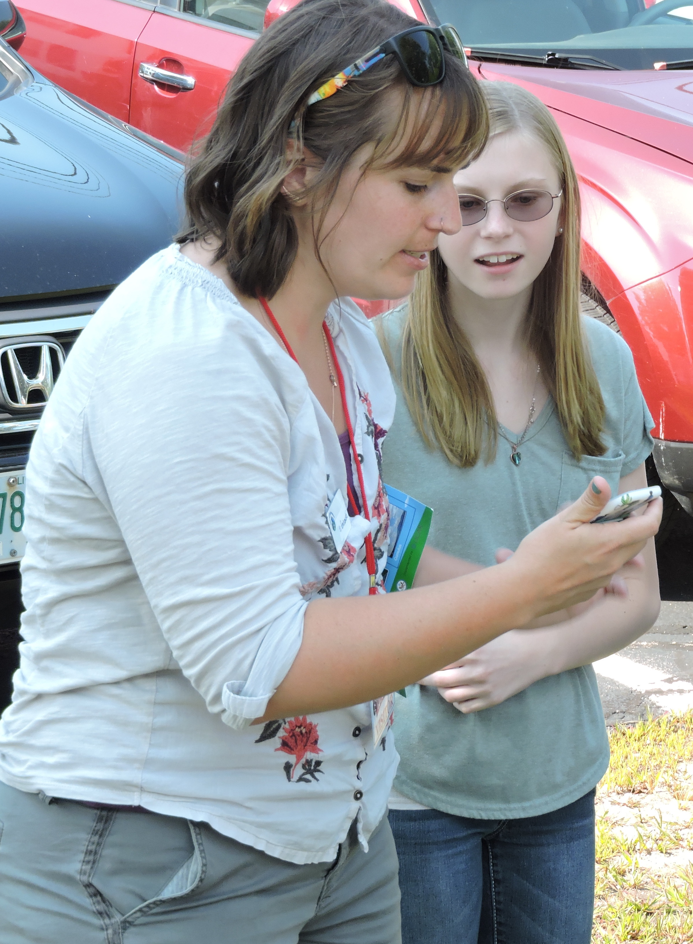 female graduate student with young female student looking with interest at the NASA observer app