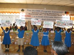 Childen holding GLOBE signs