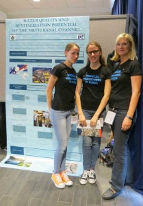 Students from Medicinska skola u Rijeci stand with their teacher in front of their poster