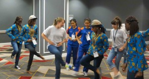After making the video, the girls from the United States teach the others some new country line dancing moves
