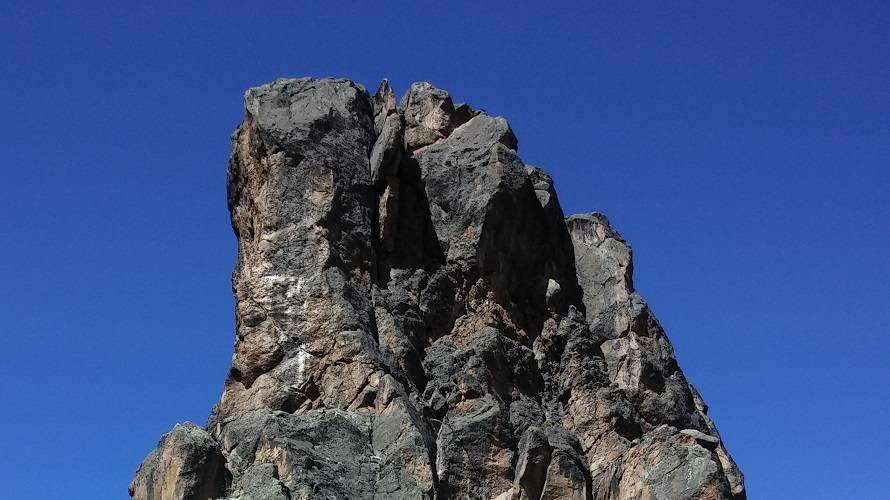 A sharp and steep rock formation.