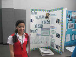 saeda in front of poster board