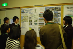 people looking at a poster