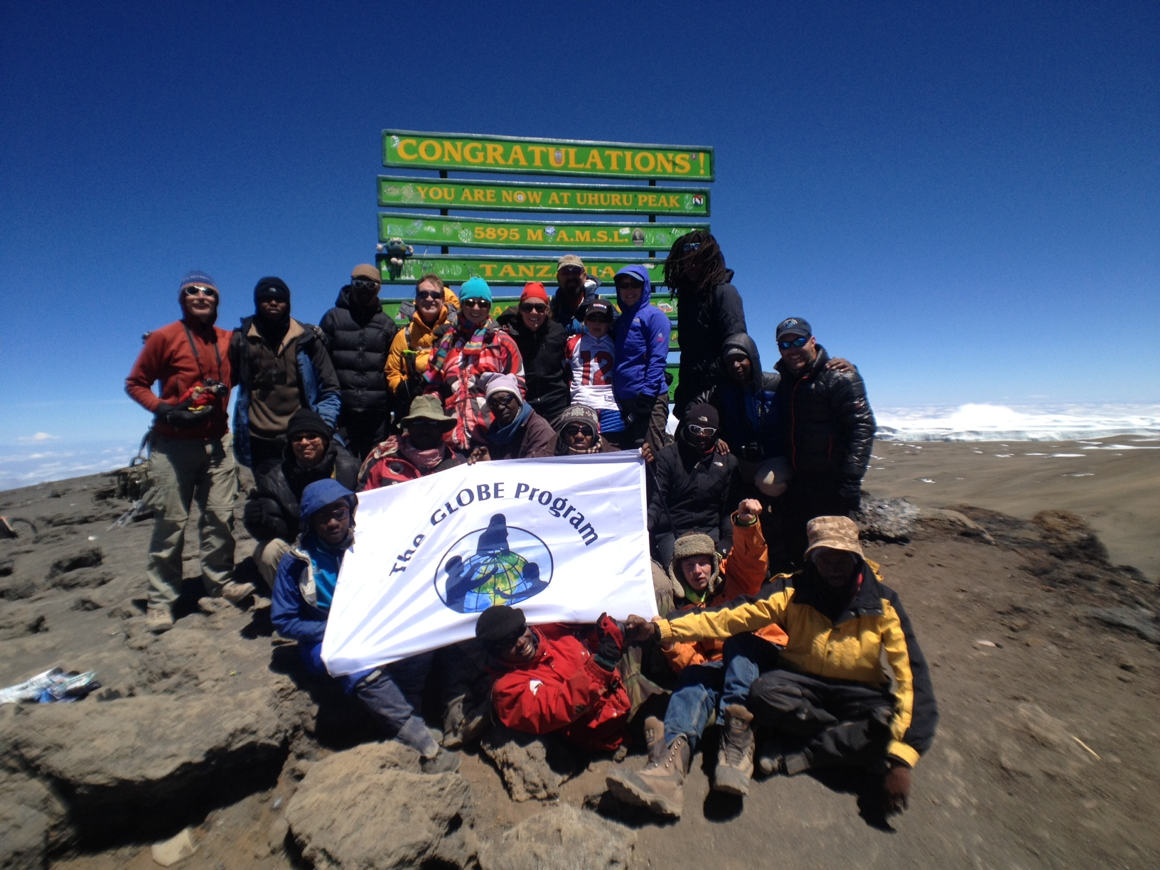 The team at the summit of Mt. Kilimanjaro