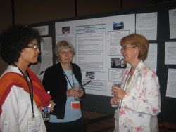 3 women in front of a research poster