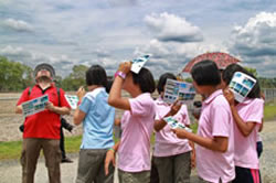 Students looking at clouds.
